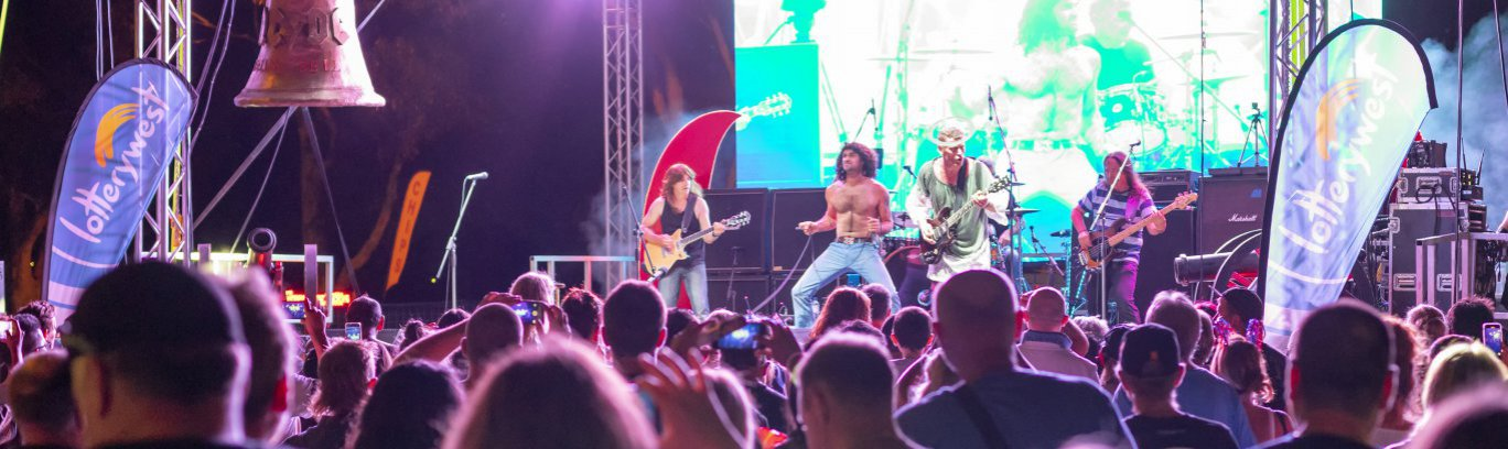 AC/DC/ tribute band singing on stage at Australia Day