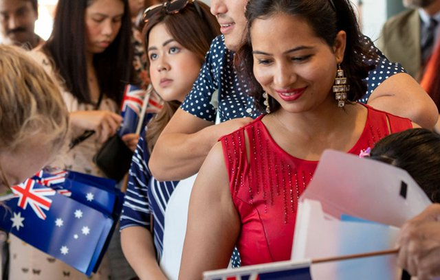 People line up to register for the Citizenship event