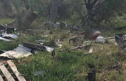 Rubbish dumped near bushland