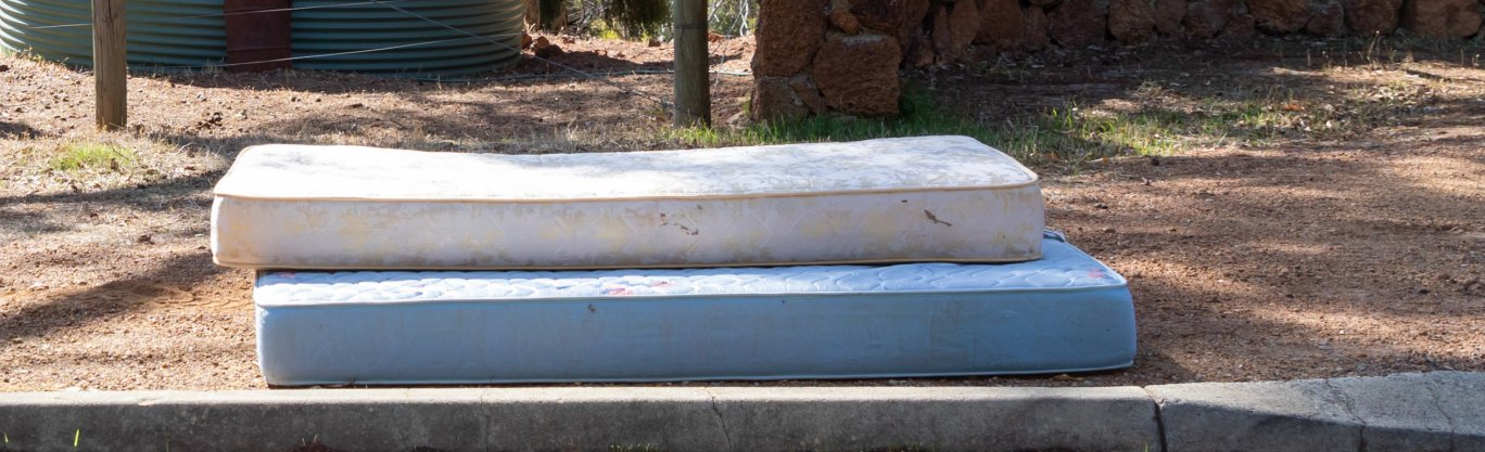 Picture of mattresses presented on verge for collection