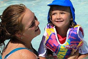 Parent and child swimming